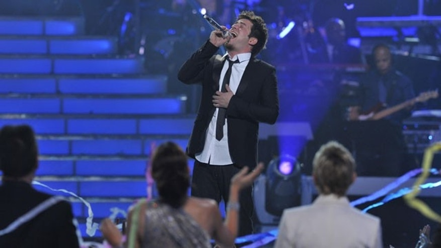 "May 26: In this publicity image released by Fox, season nine winner Lee DeWyze performs during the ""American Idol"" finale at the Nokia Theatre in Los Angeles."