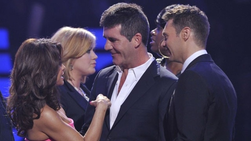 "May 26: In this publicity image released by Fox, former Idol judge Paula Abdul returns to say goodbye to Simon Cowell during the ""American Idol"" finale at the Nokia Theatre in Los Angeles."