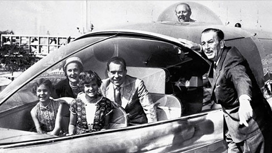 Vice President Richard Nixon and family at Disneyland, June 1959; Walt Disney is at right, and Art Linkletter in the bubble on top.