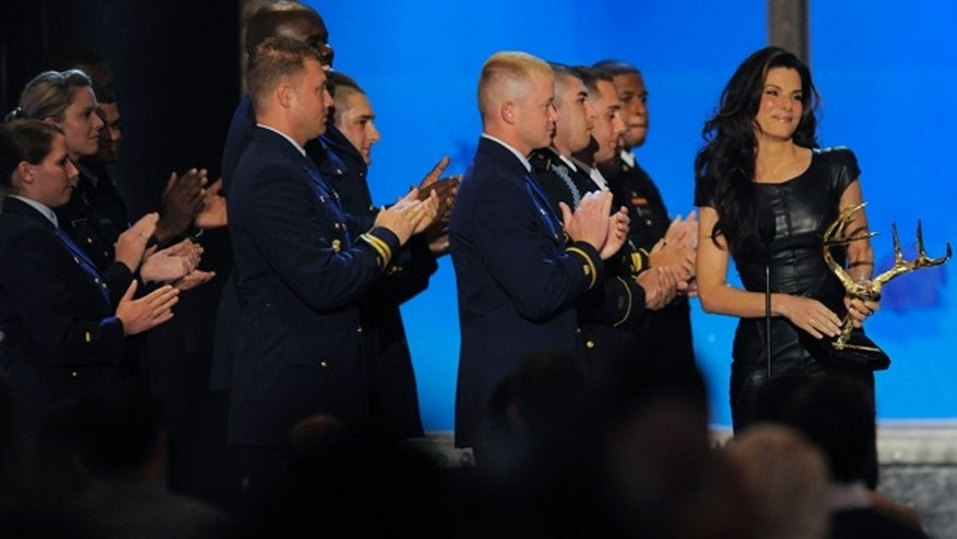 "June 5: Sandra Bullock accepts the Troops Choice Award onstage at Spike TV ""Guy's Choice"" awards in Culver City, Calif."