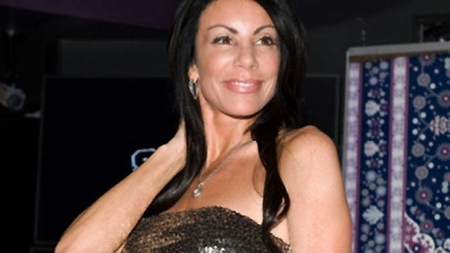 June 8: 'Real Housewives' star Danielle Staub parties at SCORES, a legendary topless bar, in New York City.