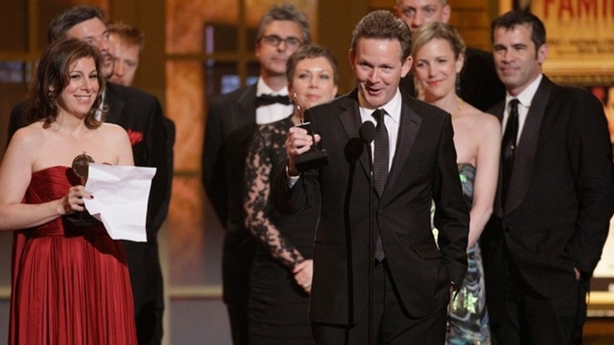 """June 13: Author John Logan accepts the Tony Award for Best Play for """"Red"""" during the 61st Tony Awards in New York."""