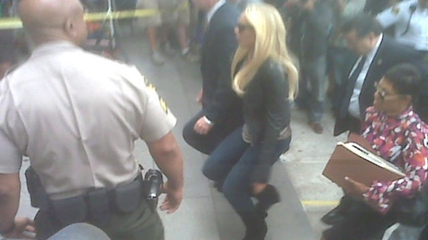 July 20: Lindsay Lohan walks into the courthouse to face Superior Judge Marsha Revel before she begins her 90-day jail sentence.