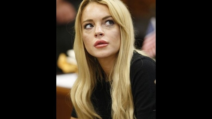 July 6: Actress Lindsay Lohan appears in a courtroom for a probation revocation hearing in Beverly Hills, Calif.