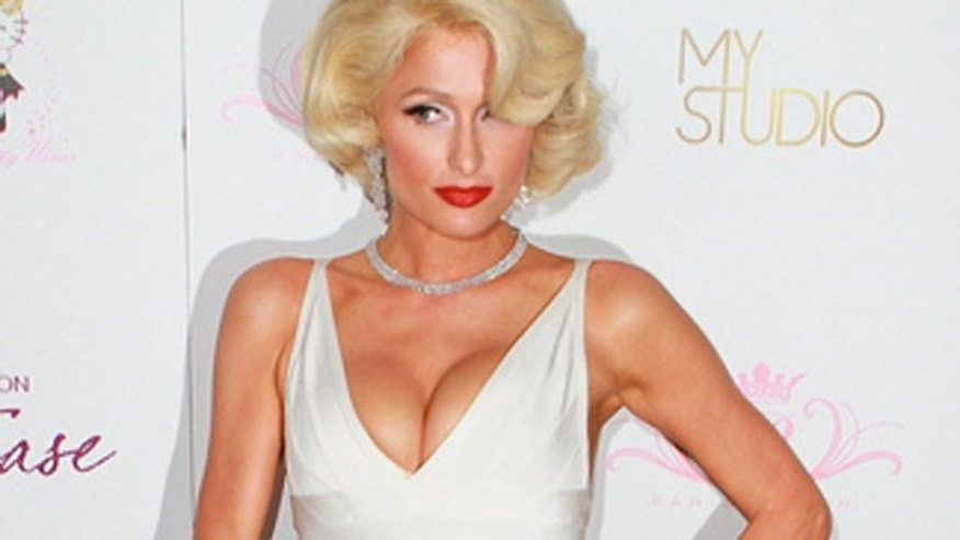 Paris Hilton appeared as Marilyn Monroe on the red carpet while promoting her new fragrance. Is Paris the queen of silly endorsements?