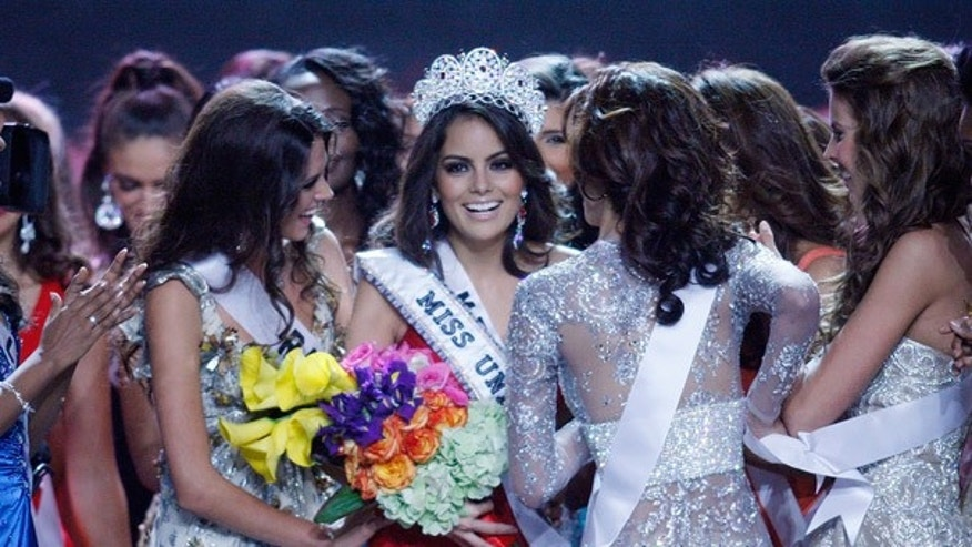 Aug. 23: Jimena Navarrete is congratulated by fellow contestants after being crowned Miss Universe.