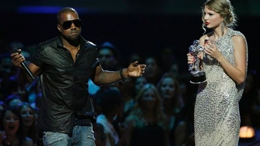 "Sept 13, 2009: Singer Kanye West takes the microphone from singer Taylor Swift as she accepts the ""Best Female Video"" award during the MTV Video Music Awards."