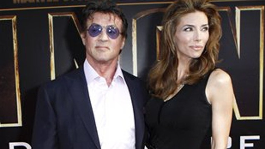 "Actor Sylvester Stallone and, wife, Jennifer Flavin arrive for the world premiere of ""Iron Man 2"" at El Capitan Theatre in Los Angeles on Monday, April 26, 2010. (AP Photo/Matt Sayles)"