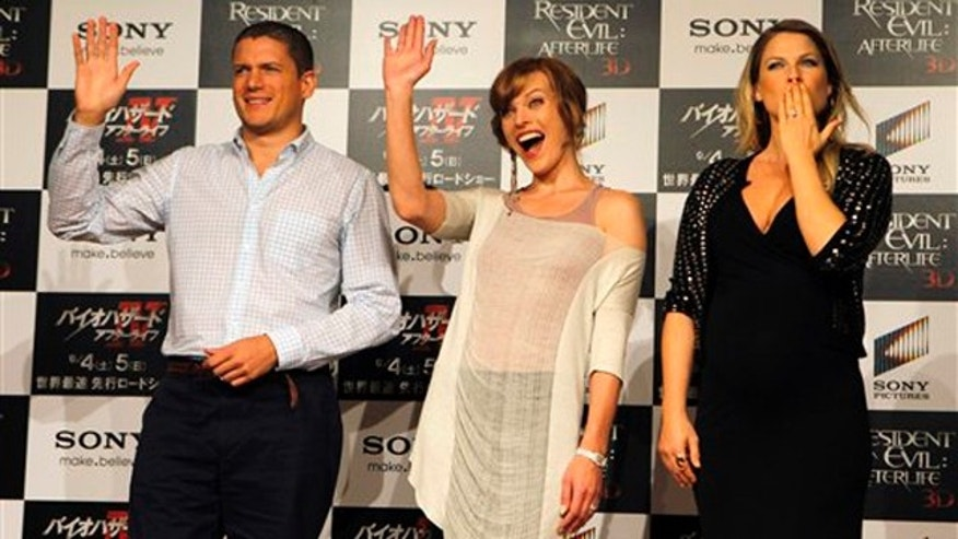 "Actresses Milla Jovovich, center, Ali Larter, right, and actor Wentworth Miller react during a press conference for their film ""Resident Evil: Afterlife"" in Tokyo Friday, Sept. 3, 2010. (AP Photo/Junji Kurokawa)"