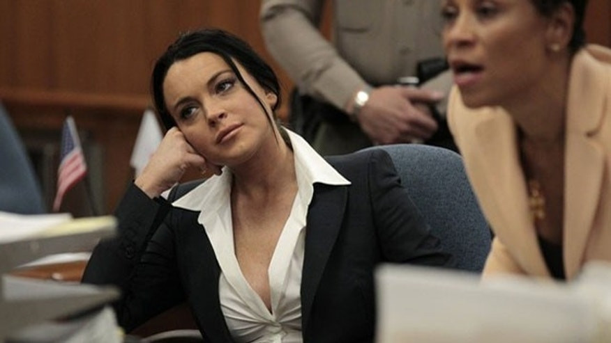 May 24: Lindsay Lohan sits in the courtroom during a probation status hearing in Beverly Hills.
