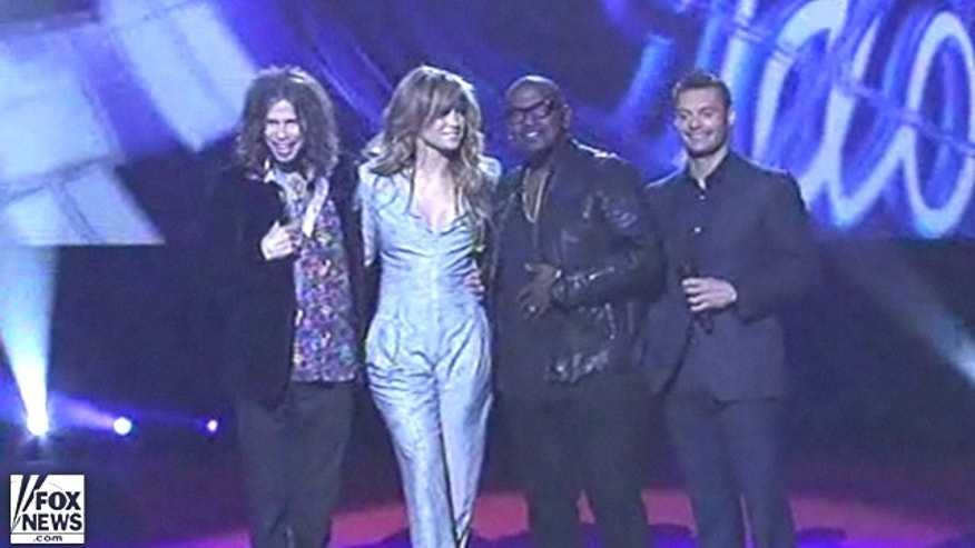 Sept. 22: Steven Tyler, Jennifer Lopez, Randy Jackson and Ryan Seacrest pose for fans after announcing the new lineup.