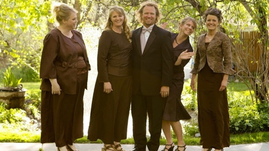 """In this publicity image released by TLC, the Browns, from left, Janelle, Christine, Kody, Meri, and Robyn from the TLC series, """"Sister Wives,"""" are shown."""