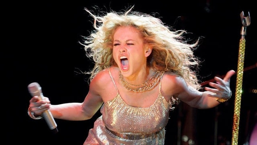 Mexican singer Paulina Rubio performs during a concert in Madrid, Thursday July 12, 2007 as part of her Spanish tour.  (AP Photo/Paul White)