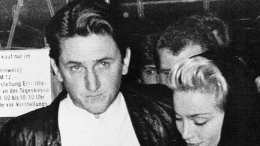 "U.S. actor Sean Penn and his wife U.S. singer Madonna leave a West Berlin cinema on February 21, 1986, where they attended Penn's newest movie picture ""At Close Range.""  REUTERS/STR"