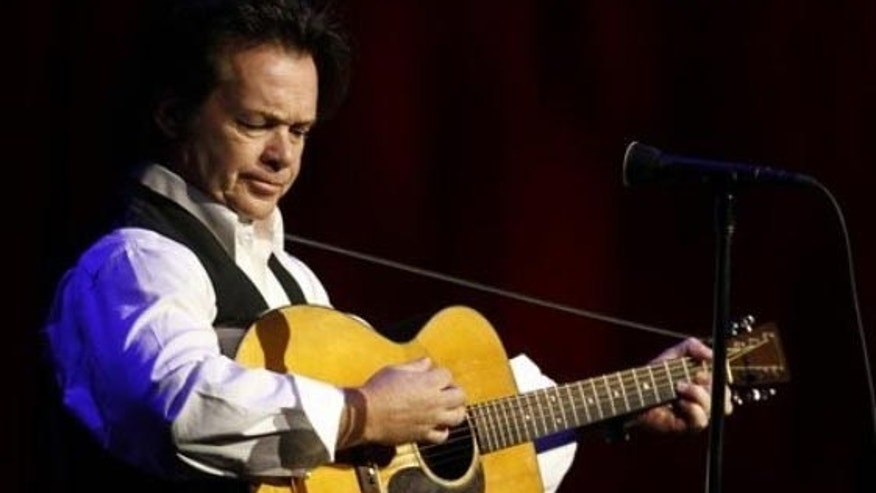 Musician John Mellencamp plays  during a tribute to former NCAA president Myles Brand in Indianapolis, Wednesday, Oct. 28, 2009. Brand died Sept. 16 at age 67 from pancreatic cancer. (AP Photo/Darron Cummings)