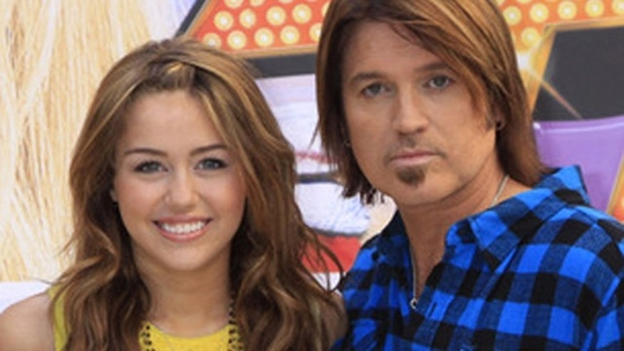"April 21, 2009: Miley Cyrus and her dad Billy Ray Cyrus their movie, ""Hannah Montana: The Movie"" in Madrid."