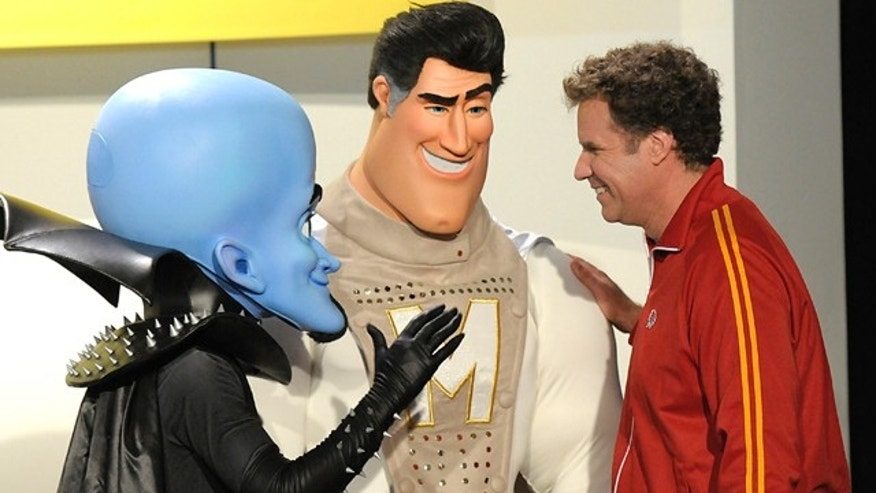 "Oct. 30: Actor Will Ferrell poses with costumed characters at the Los Angeles premiere of the animated feature film ""Megamind."""