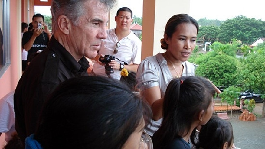 John Walsh and child rescuer Somaly Mam. (FOX/AMW)