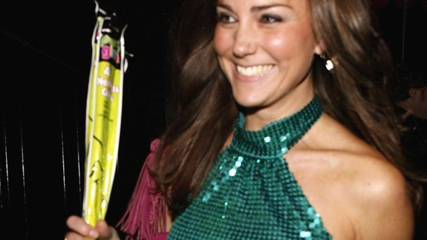 Kate Middleton arrives at a charity disco in London on Sept. 17, 2009. (AP)