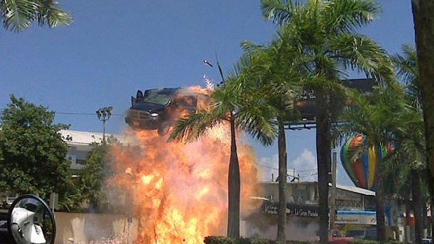 "In this photo taken Aug. 16, 2009 released by the Puerto Rico Film Commission,, a car is blown up during the filming of ""The Losers"", directed by Sylvain White, in San Juan, Puerto Rico. The Caribbean island is increasingly a backdrop in American and European cinema, standing in for Baghdad war zones, Brazilian slums, or cookie-cutter American suburbs. (AP Photo/Puerto Rico Film Commission)"