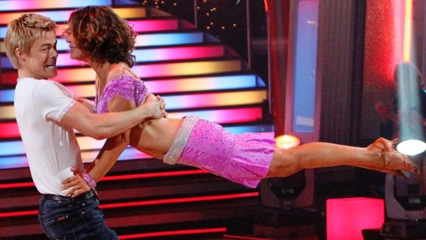 Nov. 22: In this publicity image released by ABC, Jennifer Grey, right, and her partner Derek Hough perform on the celebrity dance competition series, 'Dancing with the Stars,' in Los Angeles.