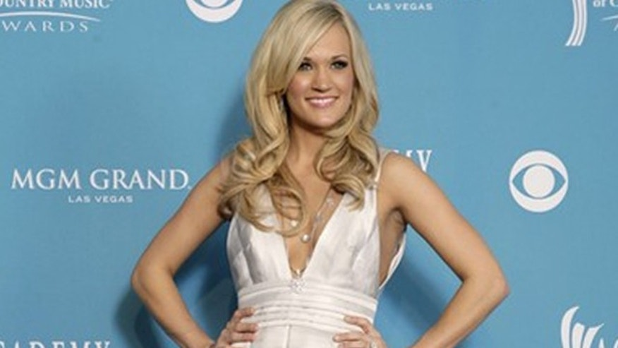 April 18: Carrie Underwood poses at the 45th annual Academy of Country Music Awards in Las Vegas.