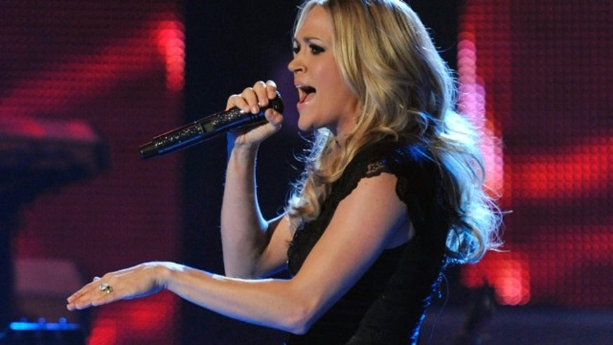 Nov. 30, 2010: Carrie Underwood performs at the CMT Artists of the Year television taping in Franklin, Tenn. She won artist of the year Dec. 6 at the American Country Awards.