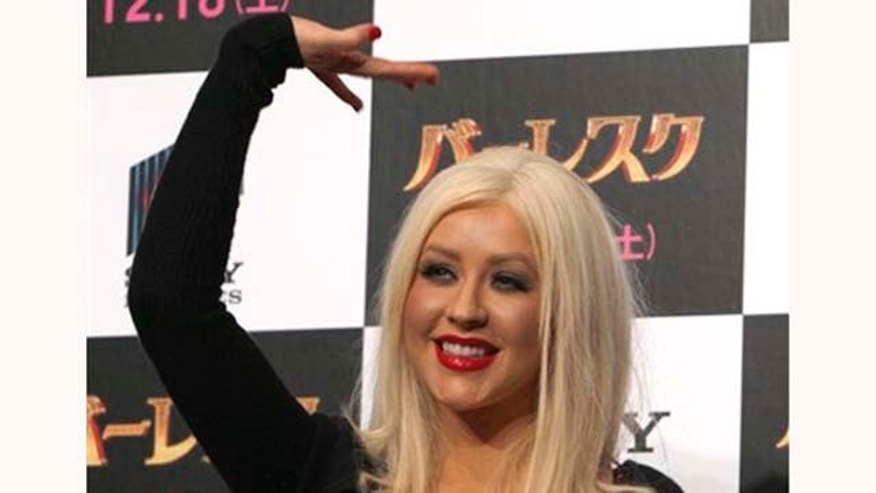 "Actress Christina Aguilera waves during a press conference of their movie of  ""Burlesque"" in Tokyo, Japan, Monday, Dec. 6, 2010. (AP Photo/Shizuo Kambayashi)"
