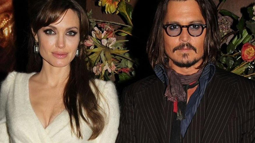 "Dec. 6: Angelina Jolie and Johnny Depp at the premiere of their new film ""The Tourist."""