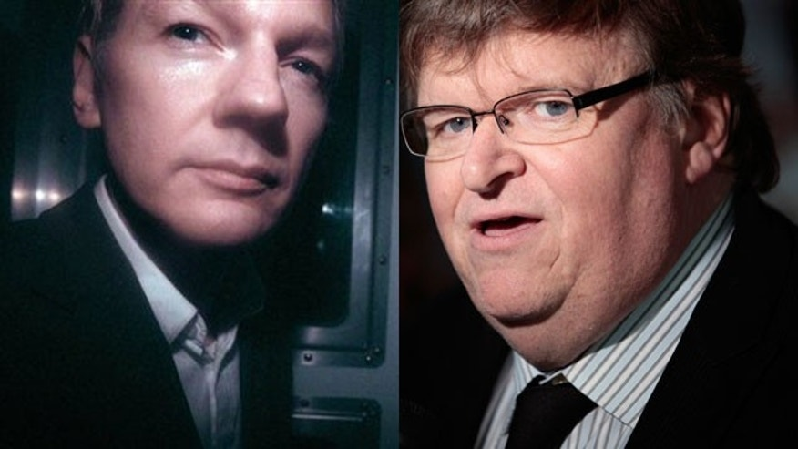 Julian Assange and filmmaker Michael Moore (AP/Reuters).