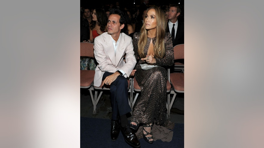 LAS VEGAS - NOVEMBER 11: Singer Marc Anthony (L) and Actress Jennifer Lopez in audience during the 11th annual Latin GRAMMY Awards at the Mandalay Bay Events Center on November 11, 2010 in Las Vegas, Nevada.  (Photo by Frazer Harrison/Getty Images for LARAS)