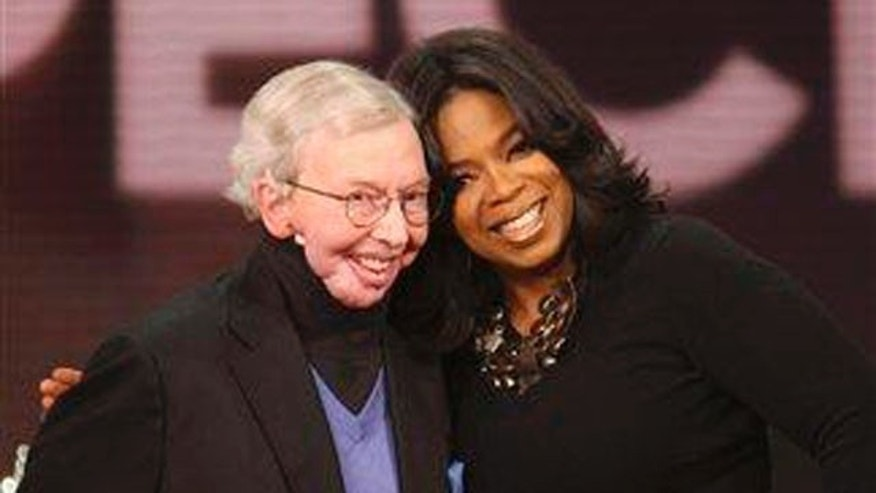 "Feb. 26: Talk-show host Oprah Winfrey, right, and film critic Roger Ebert are seen during taping of ""The Oprah Winfrey Show"" at Harpo Studios in Chicago."