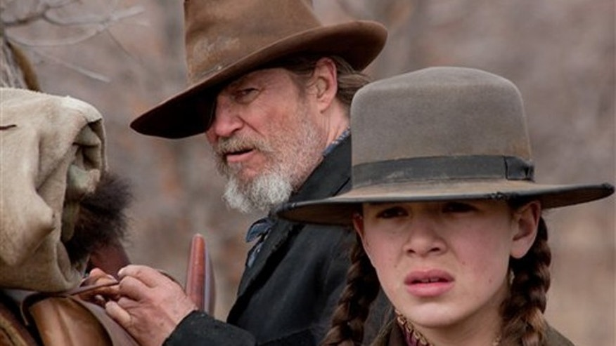 "In this undated film publicity image released by Paramount Pictures, Jeff Bridges, left, and Hailee Steinfeld are shown in a scene from ""True Grit."""