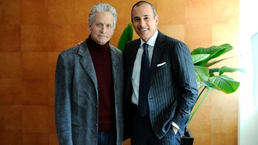 "In this publicity image released by NBC Universal, actor Michael Douglas, left, poses with Matt Lauer, co-host of the NBC ""Today"" show, for an interview, Monday, Jan. 10, 2011 , in New York.  The interview will air on Tuesday. (AP Photo/NBC, Peter Kramer)"