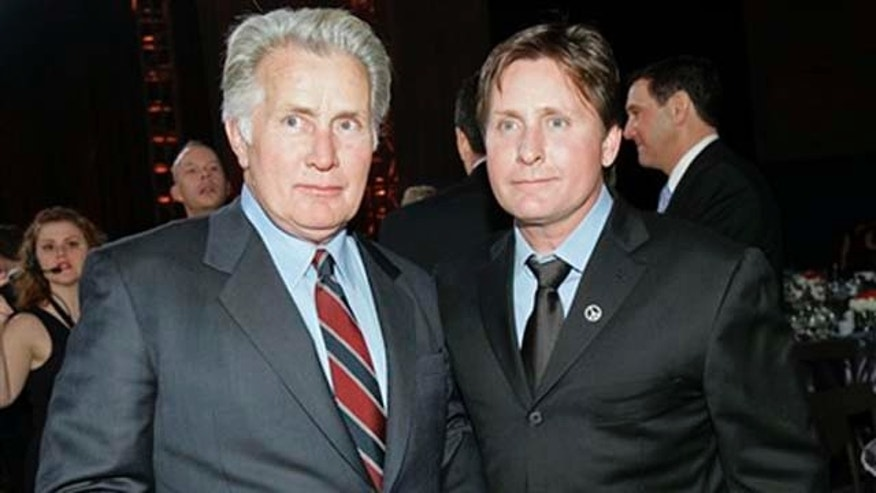 "FILE - In this Jan. 12, 2007 file photo, Martin Sheen, left, and Emilio Estevez are seen following the12th annual Critics' Choice Awards in Santa Monica, Calif. The actors are working on a joint memoir, ""Along the Way."" Free Print, an imprint of Simon & Schuster, announced Tuesday, Jan. 18, 2011 that the book would come out on Father's Day in 2012.  (AP Photo/Kevork Djansezian, file)"