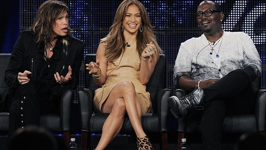 Jan. 11: Steven Tyler, left, Jennifer Lopez, center, and Randy Jackson, judges on the FOX show 'American Idol' take part in a panel discussion during the FOX Broadcasting Company Television Critics Association winter press tour in Pasadena, Calif.
