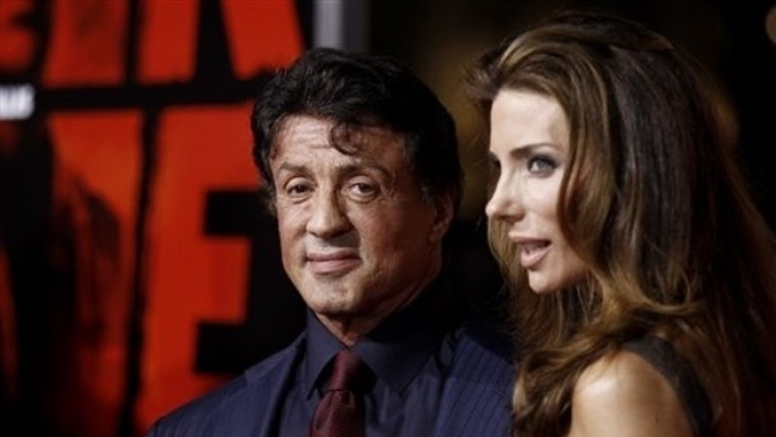 "Oct. 11: Actor Sylvester Stallone, left, and Jennifer Flavin arrive at a special screening of the film ""Red."""