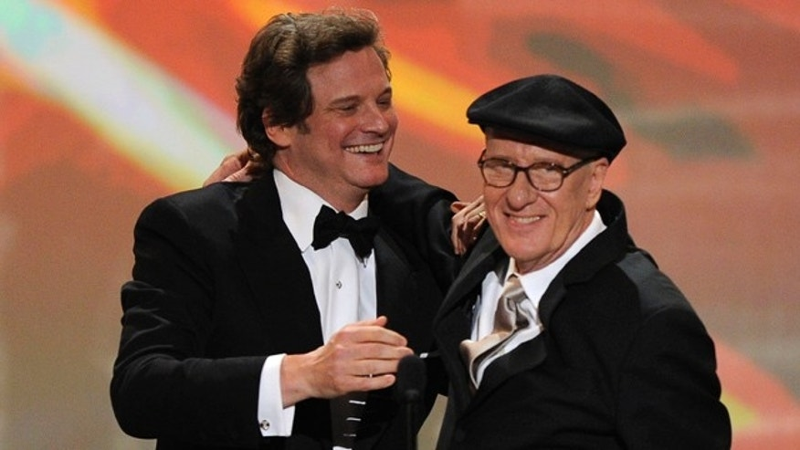 "Jan. 30, 2011: From left, Colin Firth and Geoffrey Rush, cast of ""The King's Speech,"" accept the award for best cast in a motion picture at the 17th Annual Screen Actors Guild Awards in Los Angeles."