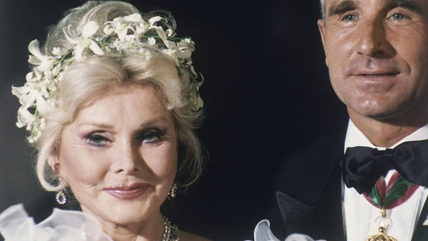 FILE-In this Aug. 14, 1986 file photo, Zsa Zsa Gabor and her eighth husband Prince Frederic von Anhalt are seen at her home in the Bel Air section of Los Angeles after their wedding.