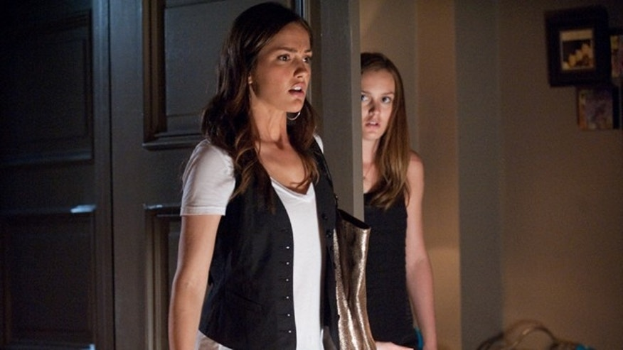 "In this film publicity image released by Sony Pictures, Minka Kelly, left, and Leighton Meester are shown in a scene from ""The Roommate."""