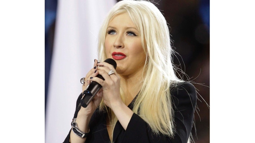 Christina Aguilera sings the national anthem before the NFL football Super Bowl XLV game between the Green Bay Packers and the Pittsburgh Steelers on Sunday, Feb. 6, 2011, in Arlington, Texas. Aguilera said she flubbed a line as she belted out the national anthem at the start of the Super Bowl on Sunday night after getting lost in the moment and losing her place.(AP Photo/David J. Phillip)