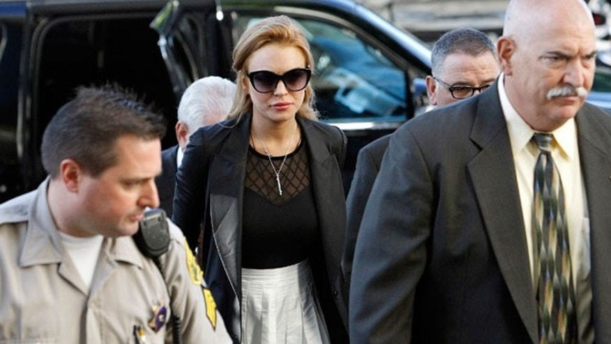 Sept. 24: Lindsay Lohan arrives at a court hearing in Los Angeles after failing a court-mandated drug test. She will now appear in a biopic about John Gotti.
