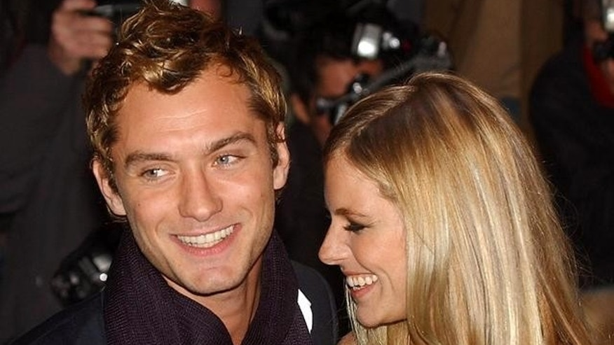 Jude Law and Sienna Miller. (AP)