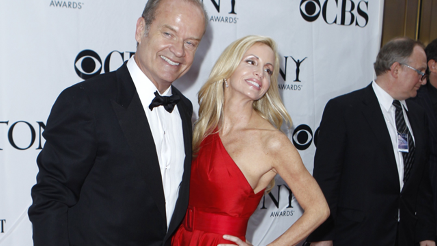 Kelsey grammer and his estranged wife Camille in New York on June 13, 2010. (Reuters)