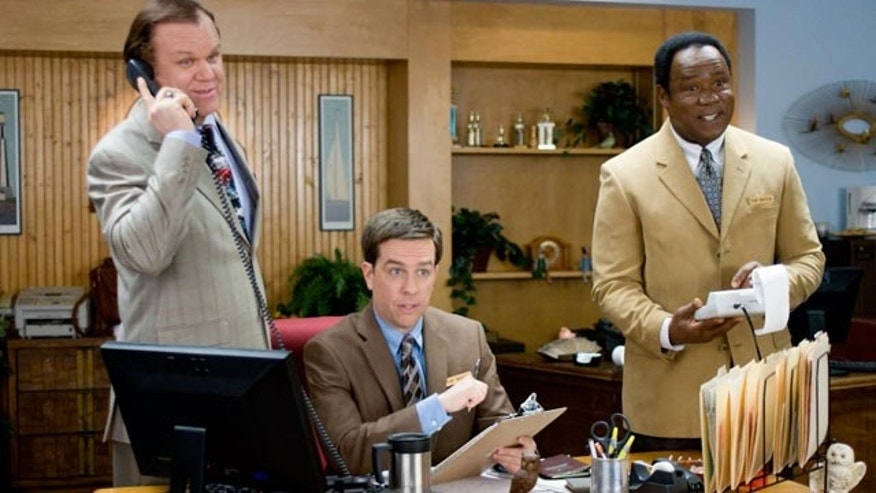 "In this film publicity image released by Fox Searchlight Films, from left, John C. Reilly, Ed Helms and Isiah Whitlock Jr. are shown in a scene from, ""Cedar Rapids."" (AP)"