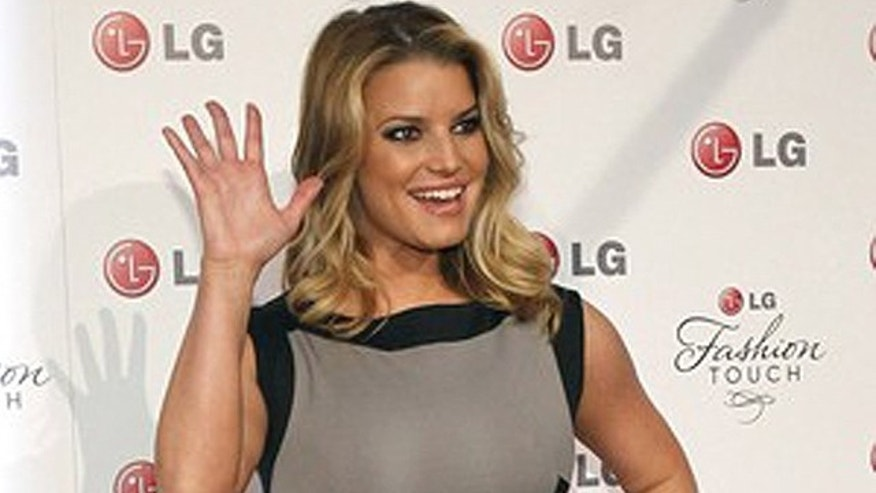 May 24: Jessica Simpson waves at the LG Fashion Touch party in West Hollywood, California.