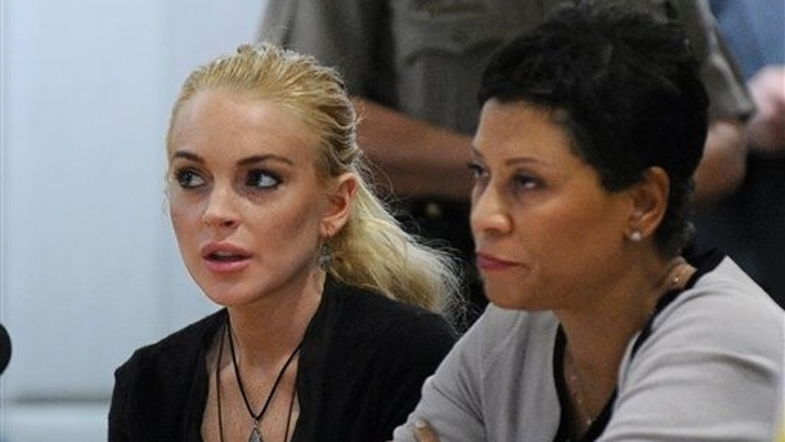 Lindsay Lohan, left, appears Los Angeles Superior Court with her attorney Shawn Chapman Holley.