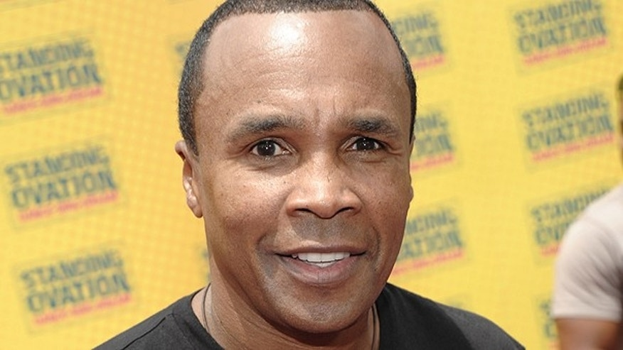 In this July 10, 2010 file photo, former professional boxer Sugar Ray Leonard arrives at the premiere of the musical feature film 'Standing Ovation' in Universal City, Calif.