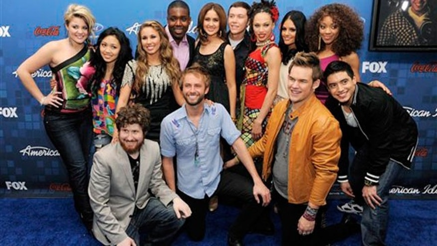 "March 3: ""American Idol"" finalists pose together at the ""American Idol"" Finalists Party in Los Angeles. (AP)"