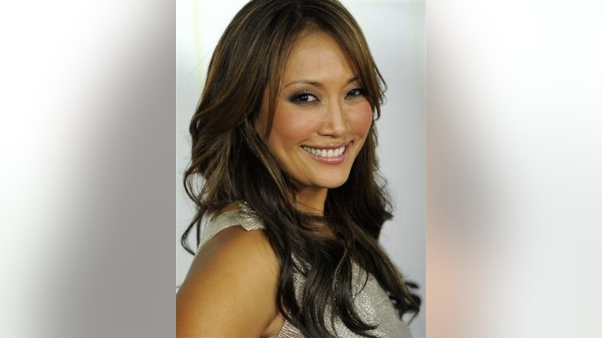 "FILE - In this Sept. 20, 2010 file photo, Carrie Ann Inaba poses at the 11th season premiere of ""Dancing with the Stars."" (AP Photo/Chris Pizzello, file)"